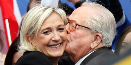 Jean-Marie Le Pen, France's National Front political party founder, embraces his daughter Marine, National Front political party leader, after her speech at their traditional rally in Paris