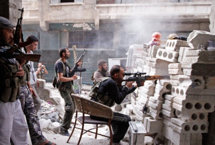 Members of the Free Syrian Army are seen at a front line in al-Mid area in Aleppo city in northern Syria October 11, 2012. REUTERS/Zain Karam (SYRIA - Tags: CIVIL UNREST POLITICS TPX IMAGES OF THE DAY)